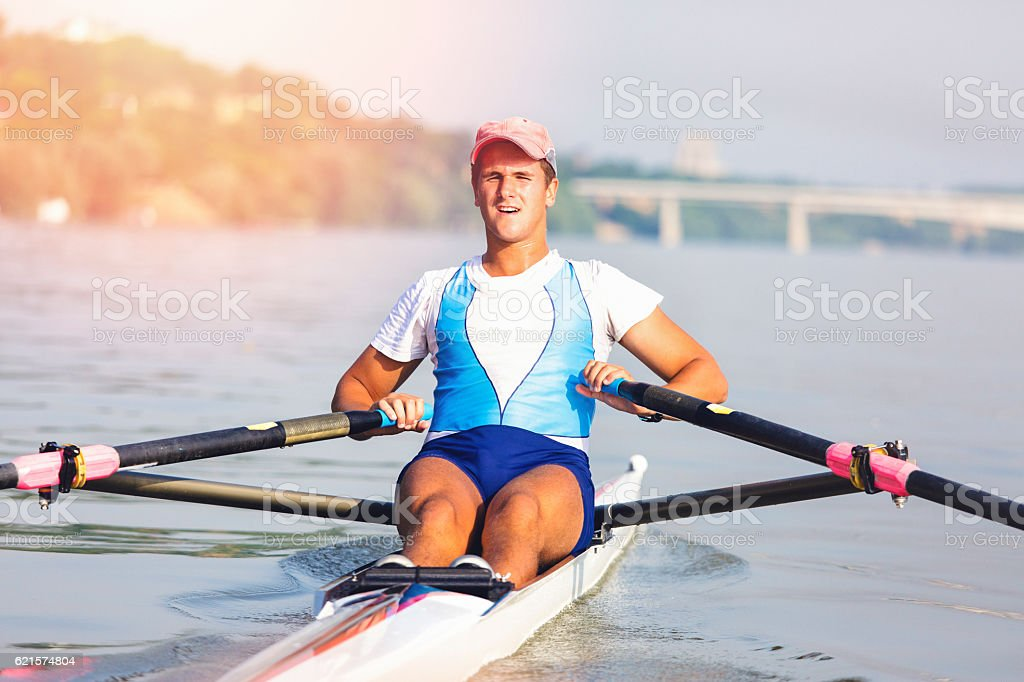 Single man rowing on the river stock photo
