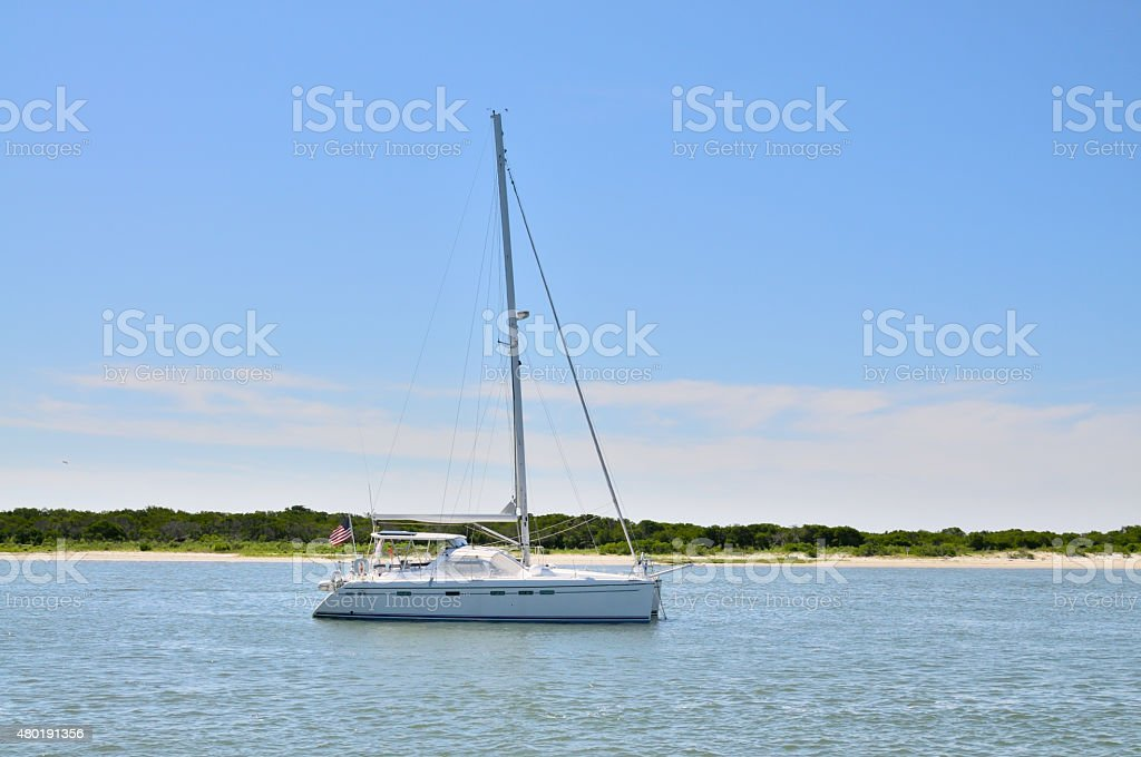 Single Masted Sailboat In Sinepuxent Bay stock photo