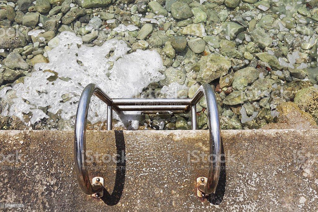 single metal ladder at turquoise mediterranean beach  Croatia royalty-free stock photo