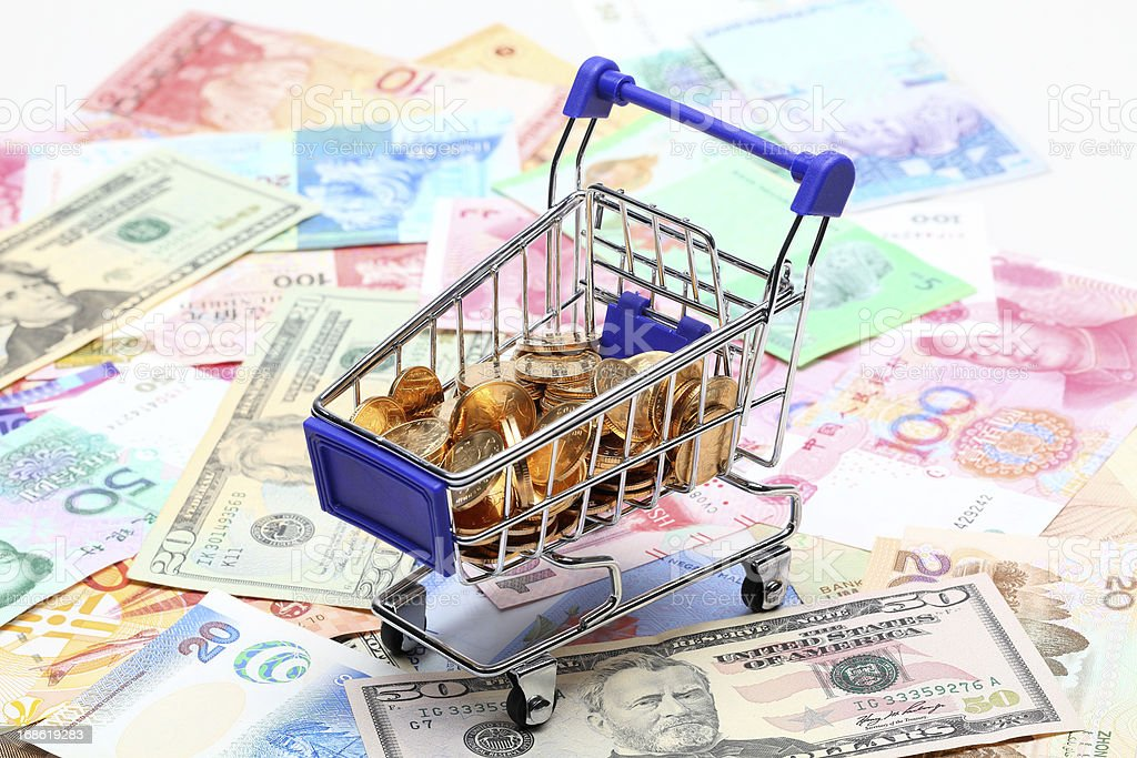 Single mini shopping cart with coins royalty-free stock photo