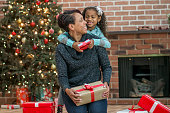 Single Mother Opening Gifts with Her Daughter