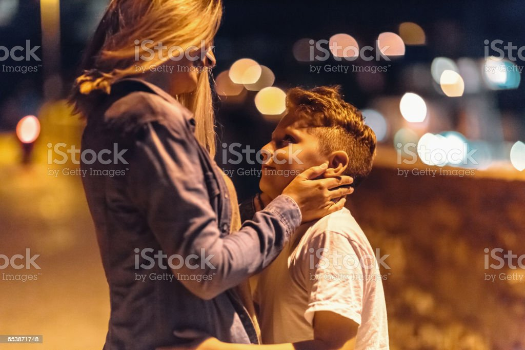 Single mother with two sons looking at sea stock photo