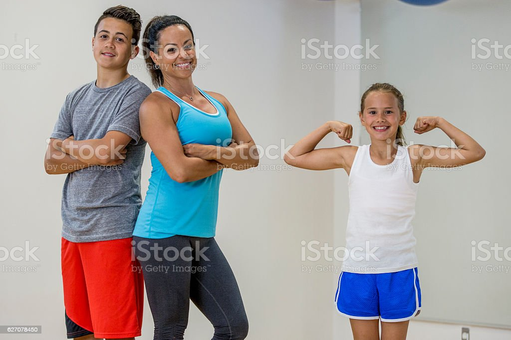 Single Mother Working Out with Her Children stock photo