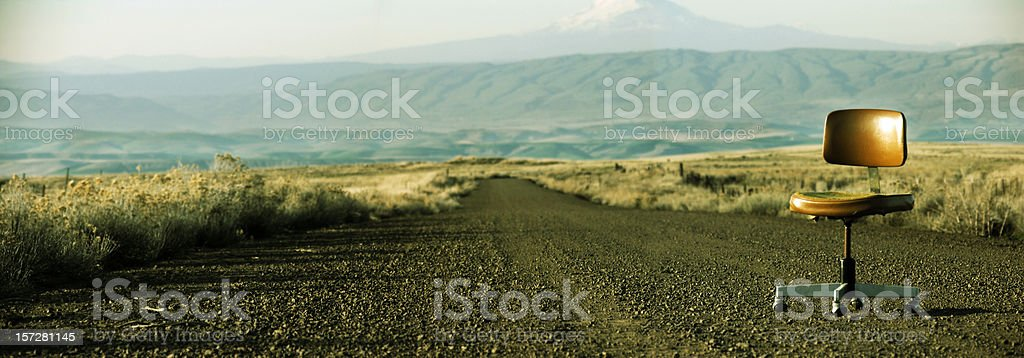 Single Office Chair on Old Dirt Road stock photo