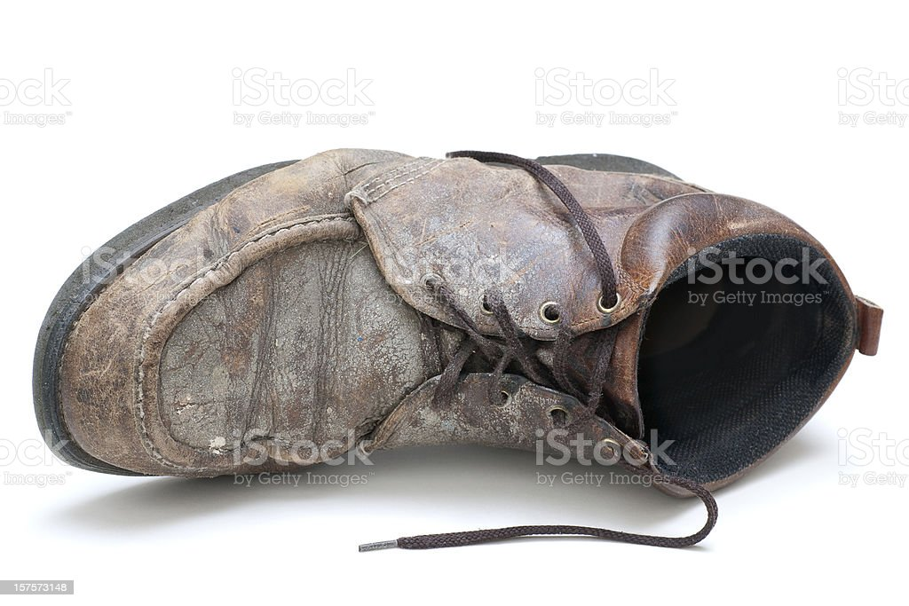 single old dirty work boot on side stock photo