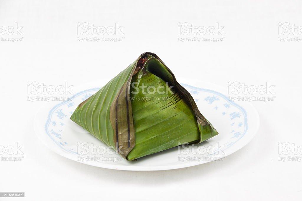 Single packs of wrapped simple and original nasi lemak stock photo