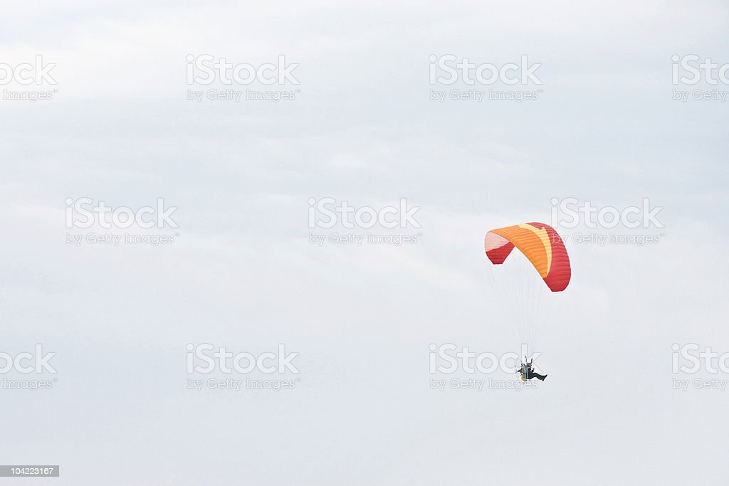 Single paraglider on a cloudy day royalty-free stock photo