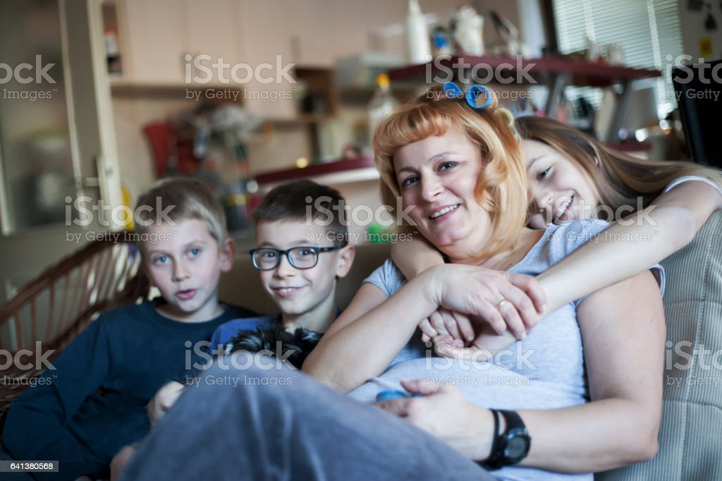 Single parent mother enjoying with her children stock photo