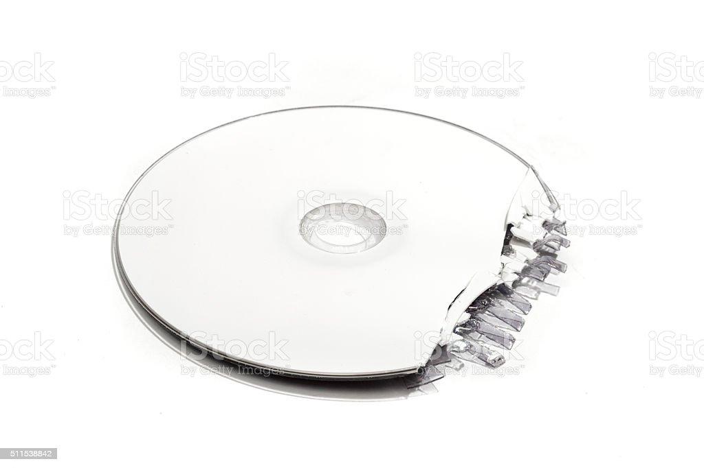 Single partially shredded DVD stock photo