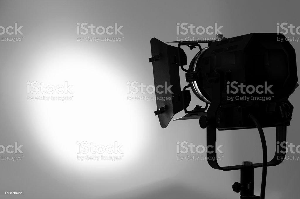 Single piece of lighting equipment lighting a white wall stock photo