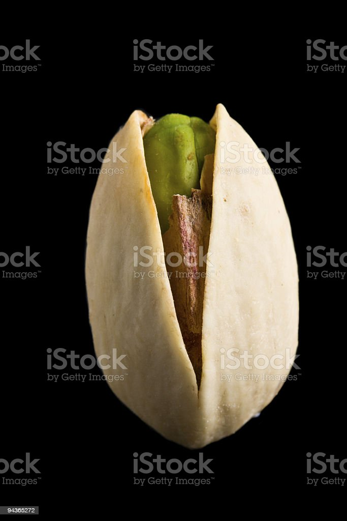 Single pistachio nut isolated stock photo