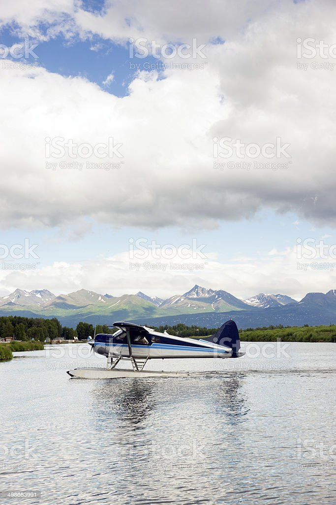 Single Prop Airplane Pontoon Plane Water Landing Alaska Last Frontier stock photo