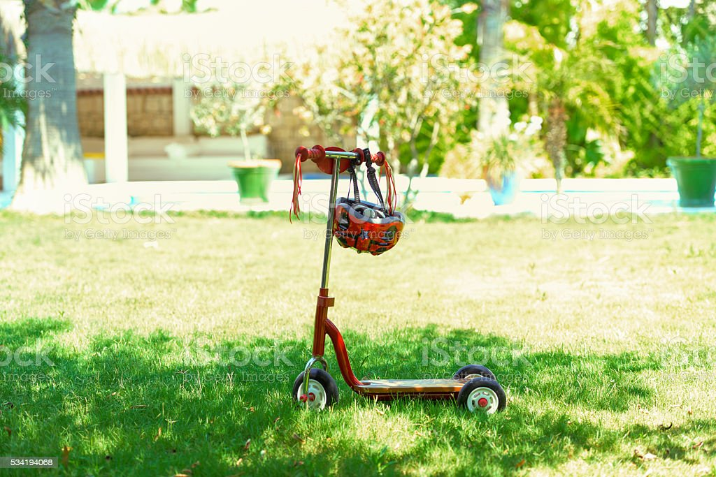 Single push-scooter for children in a garden. stock photo