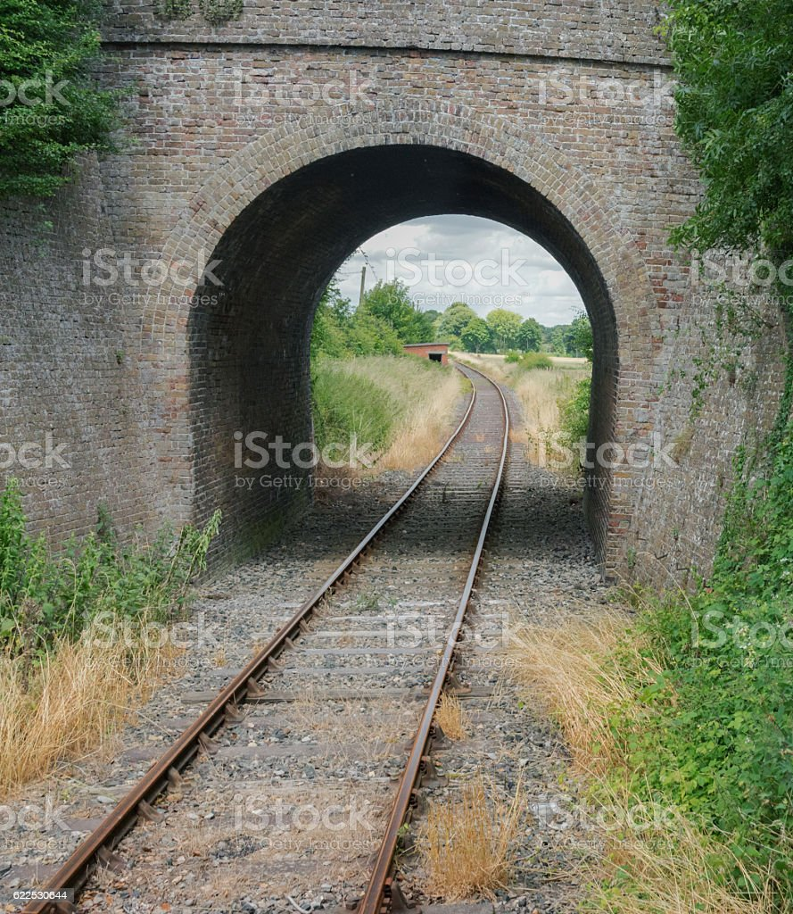 Single railway track going through a tunnel in rural England stock photo