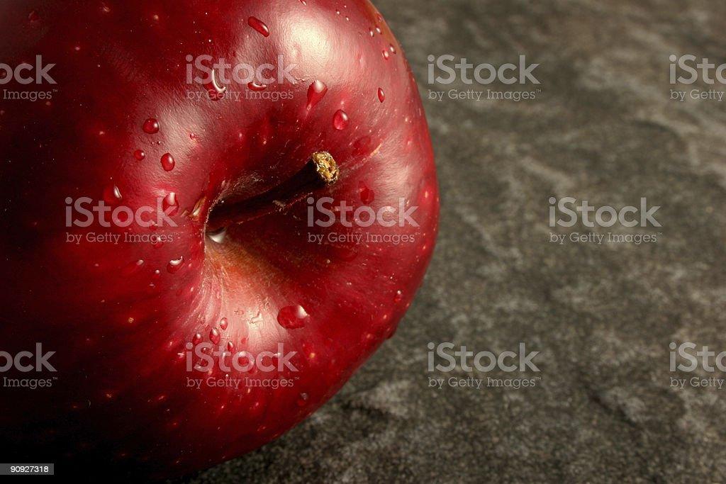 Single Red Apple on Grey Stone stock photo
