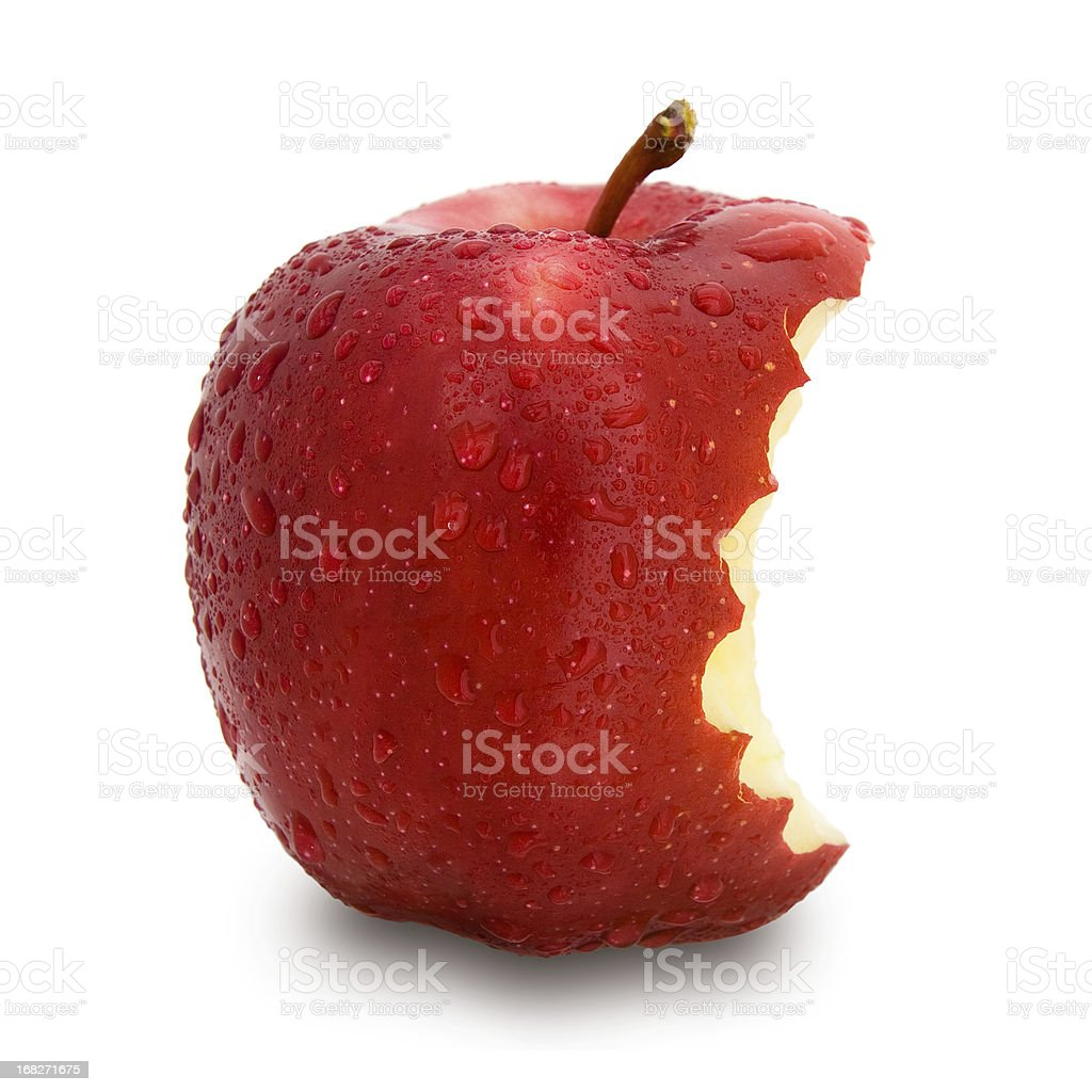 A single red apple with a bite taken out stock photo