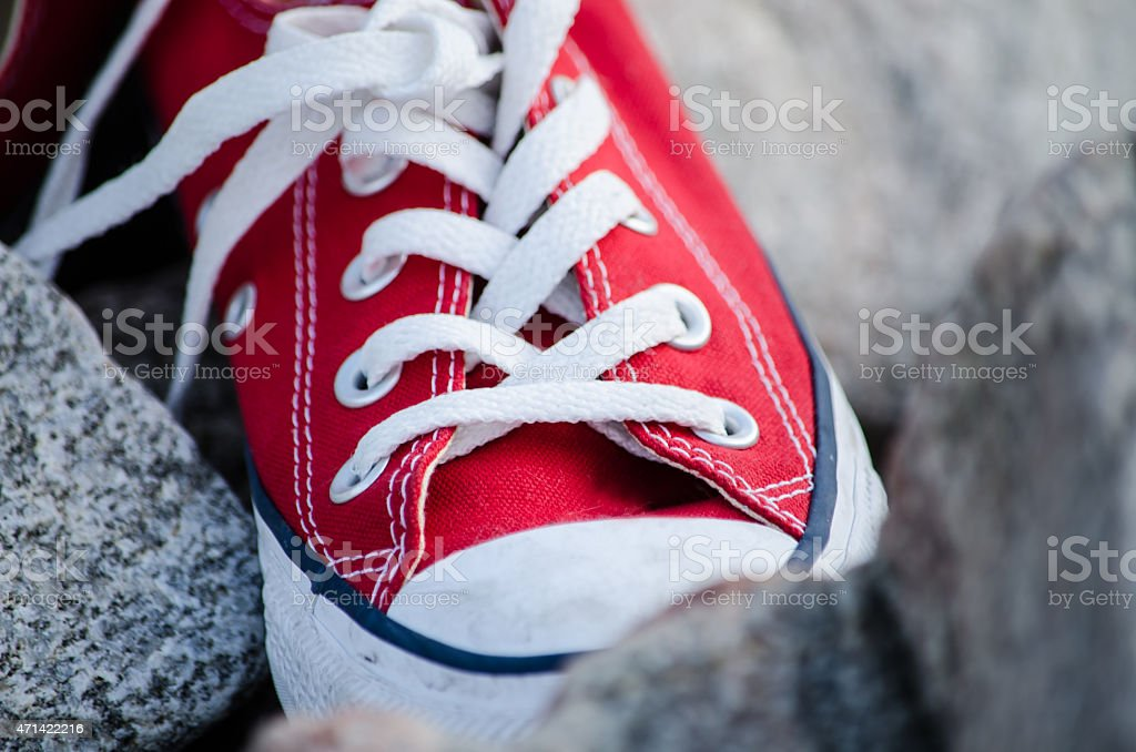 Single red converse shoe stock photo