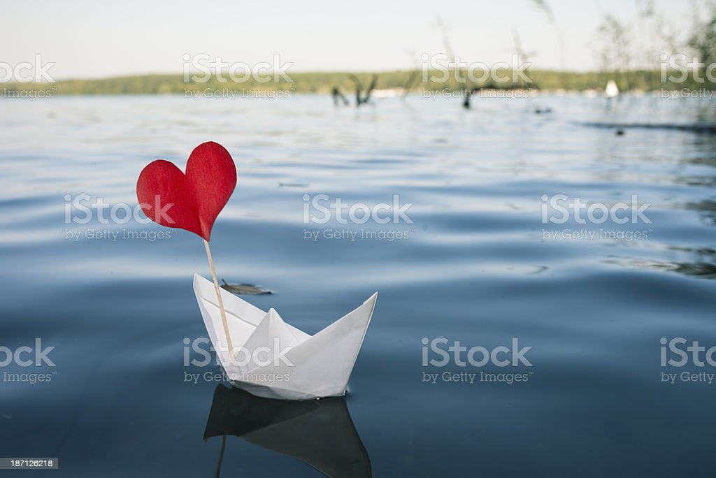 Single red heart on paper boat, natural water background royalty-free stock photo