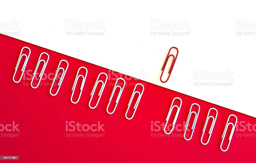 Single red paper clip breaking through normality royalty-free stock photo