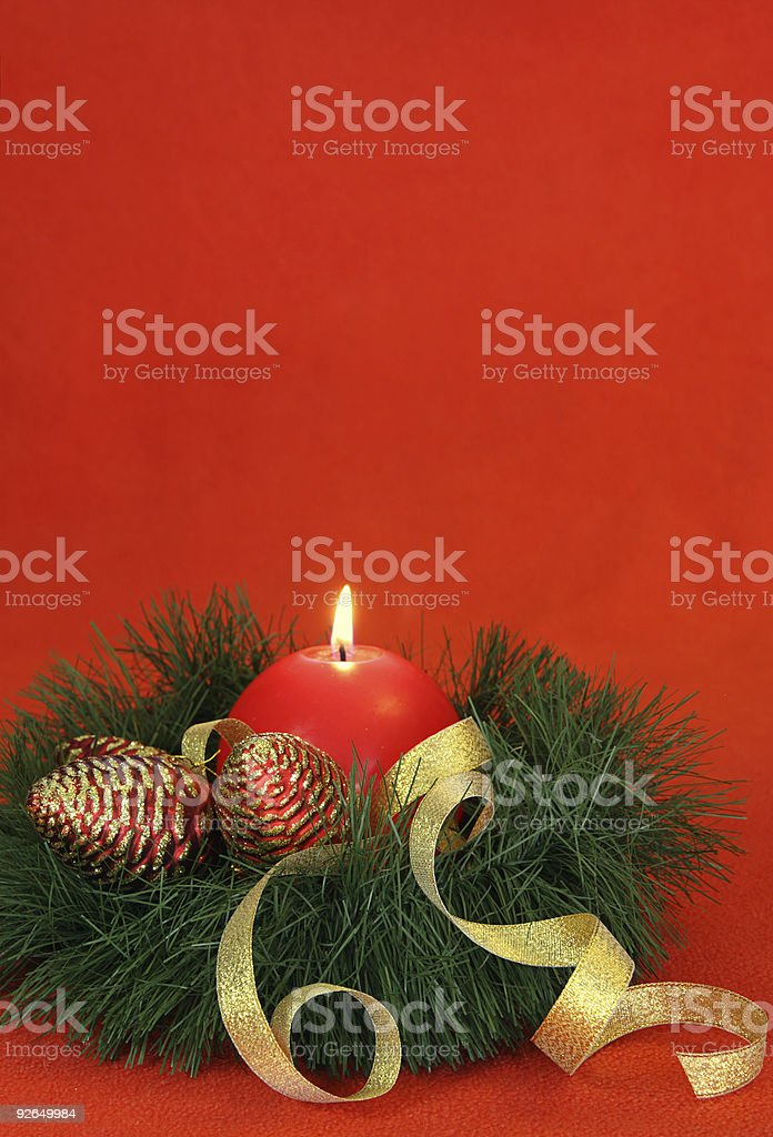 Single red round candle with pinecones , vertical royalty-free stock photo