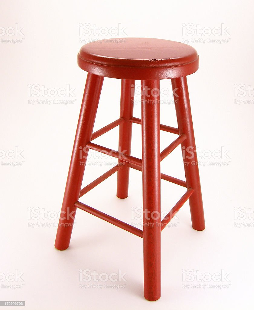 A single red stool on a white background royalty-free stock photo
