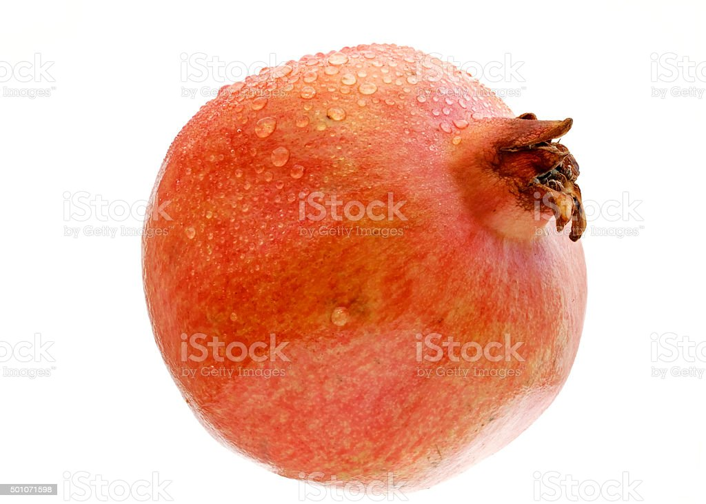 single ripe pomegranate with water drops stock photo