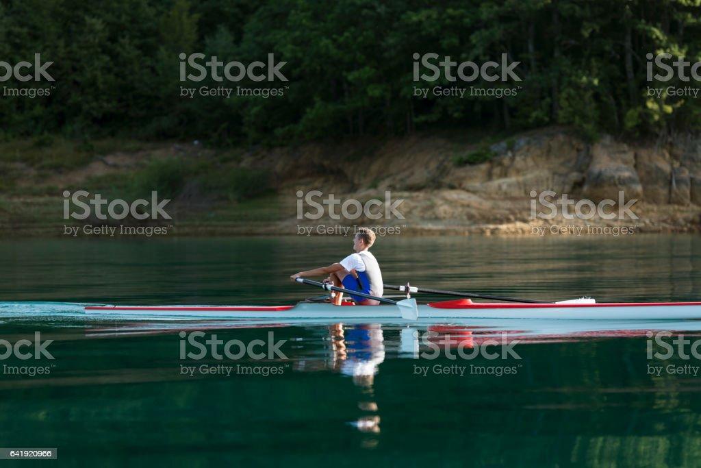 single rower at sunrise stock photo