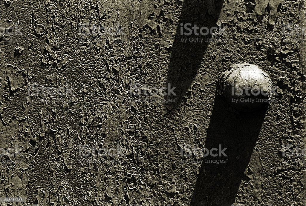 Single Rusty Rivet with Shadow stock photo