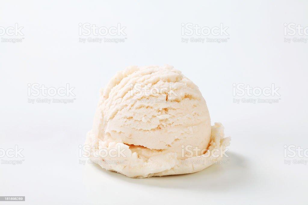 Single scoop of vanilla ice cream on a white background stock photo