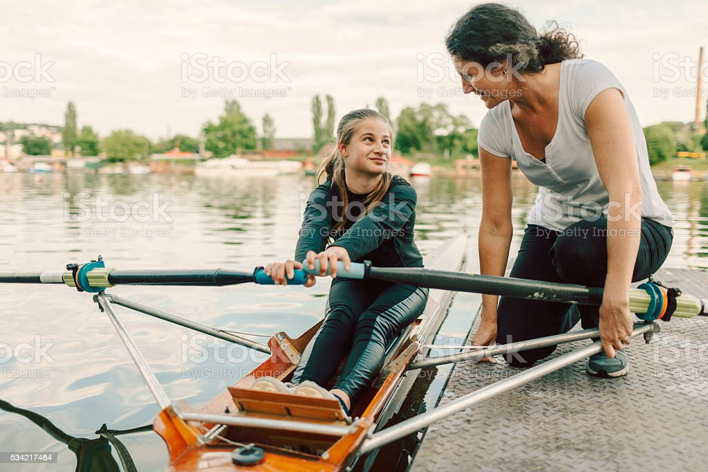Single Scull Rowing Instructions From Coach. stock photo