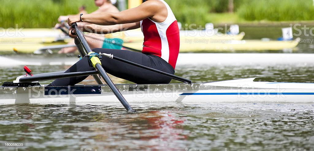 Single scull women's rowing start stock photo