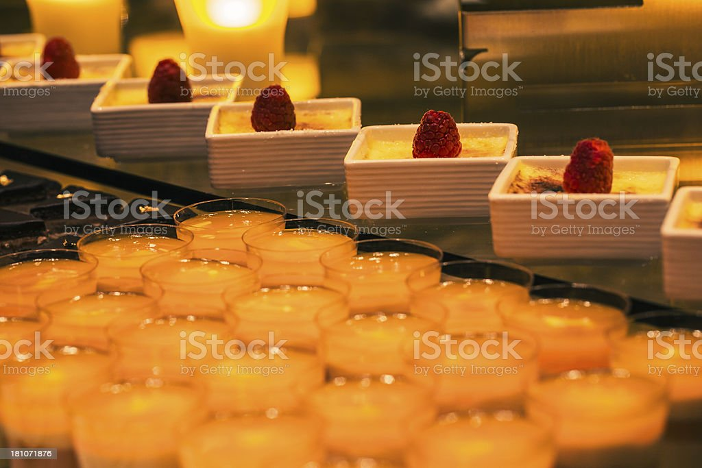 Single serving puddings and desserts at a buffet table. royalty-free stock photo