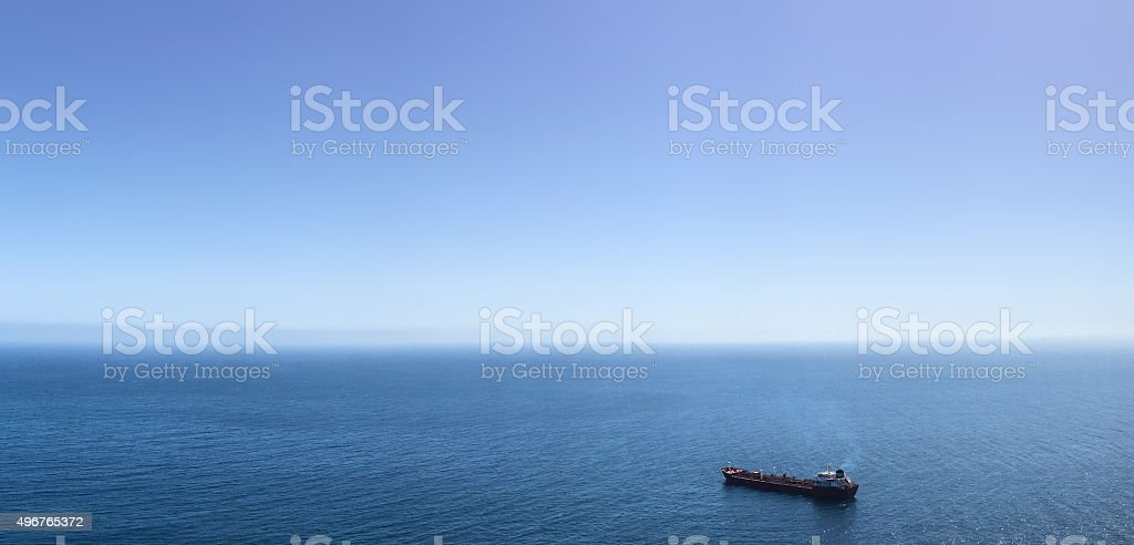 single ship on ocean panorama stock photo