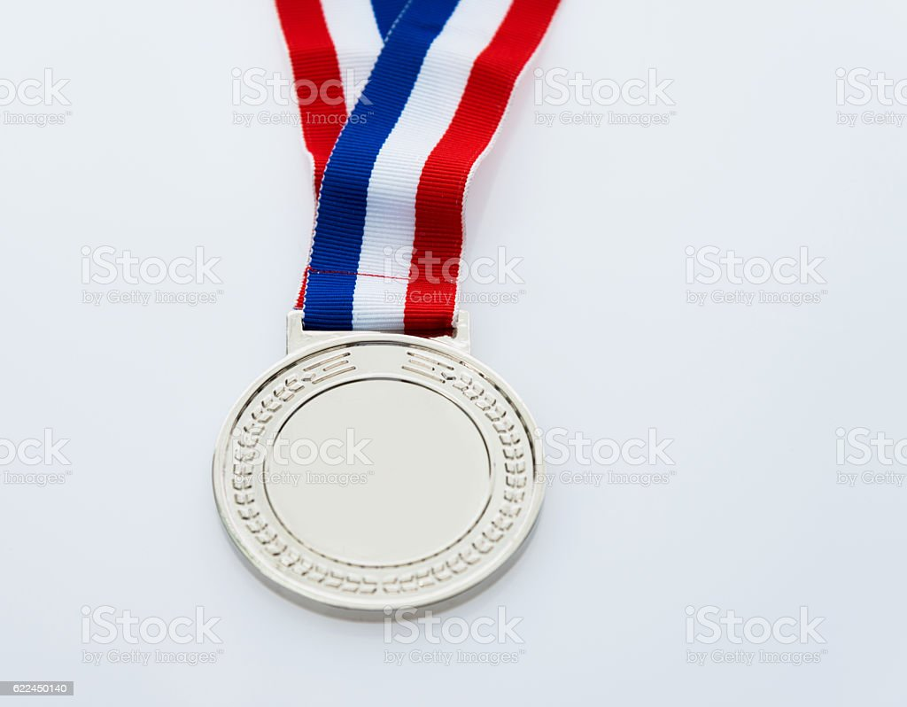 Single silver medal isolated on white background stock photo