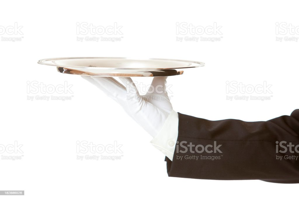 Single silver tray held by butler's hand with gloves stock photo