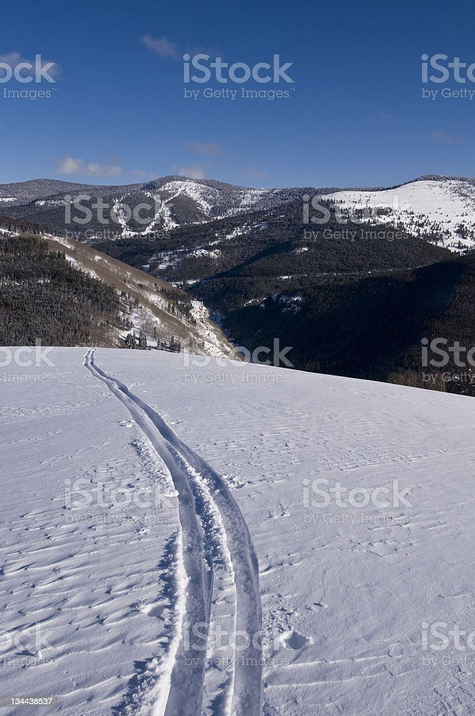 Single ski track going off in the Distance royalty-free stock photo