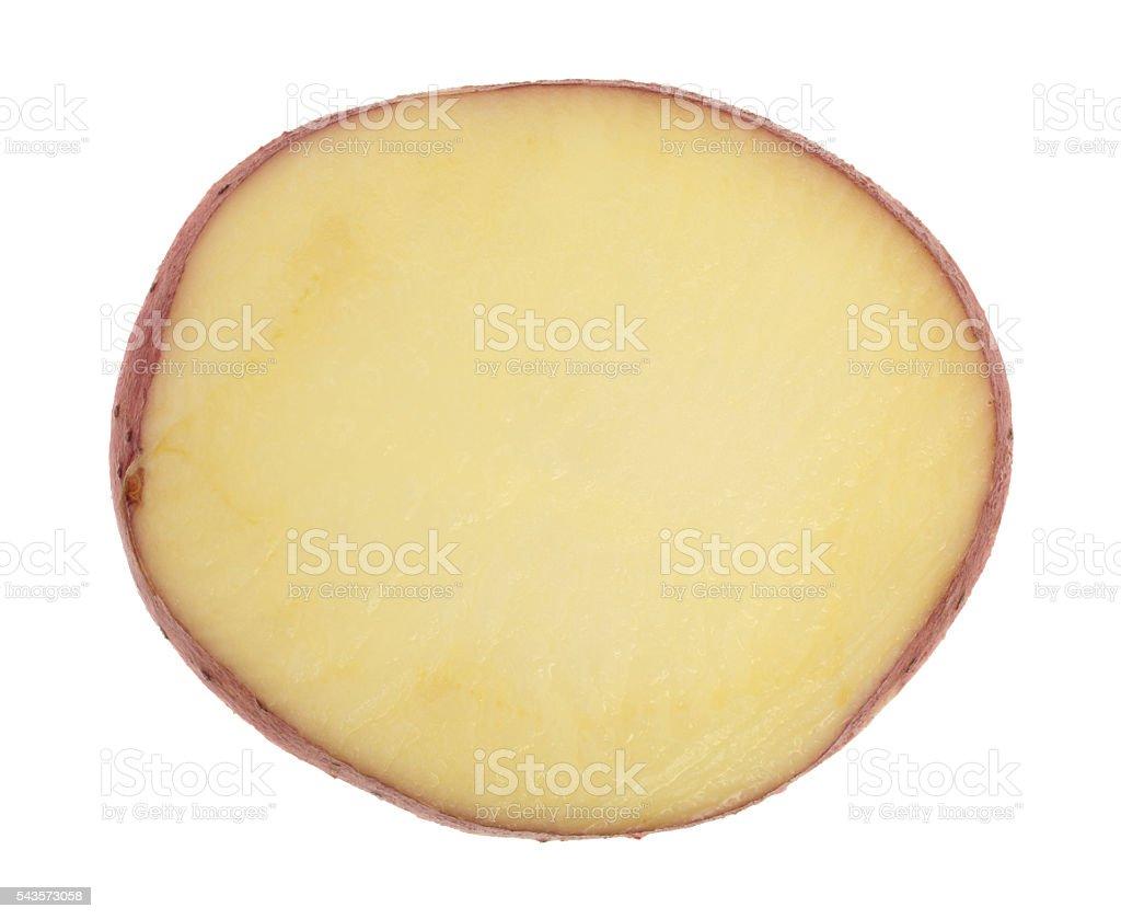 Single slice of red potato on a white background. stock photo
