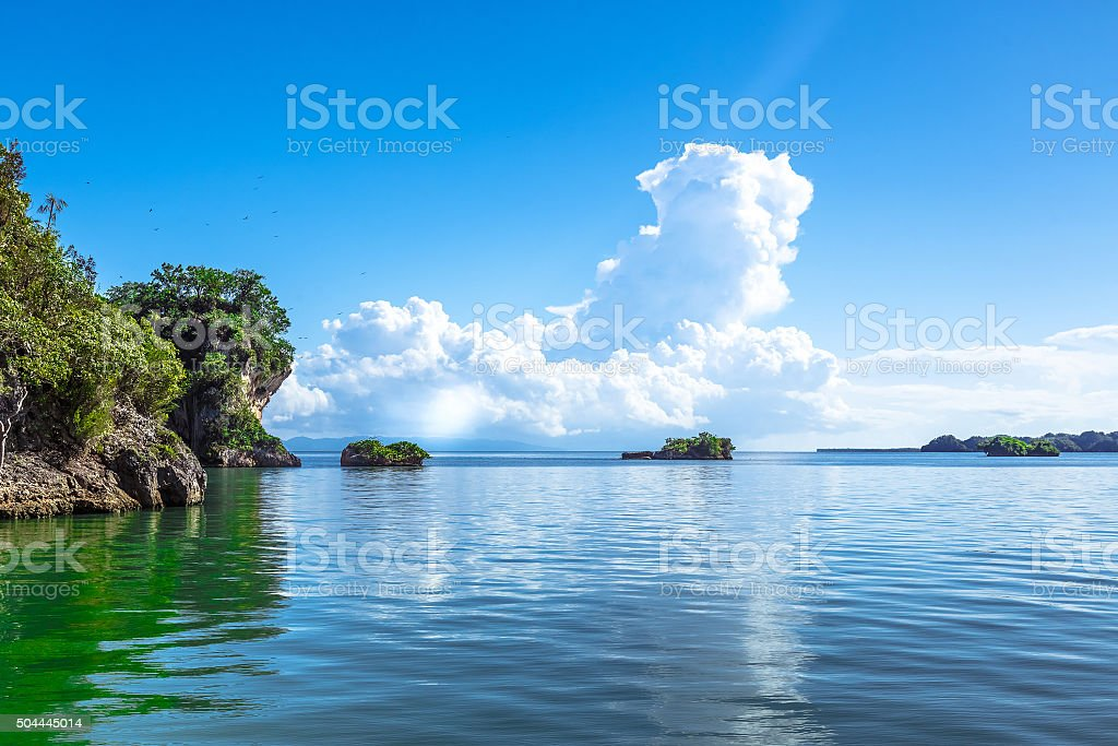 Single Small Key in the Middle of Sea stock photo