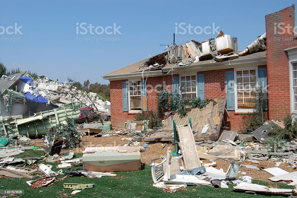 A single story home badly damaged by a hurricane stock photo