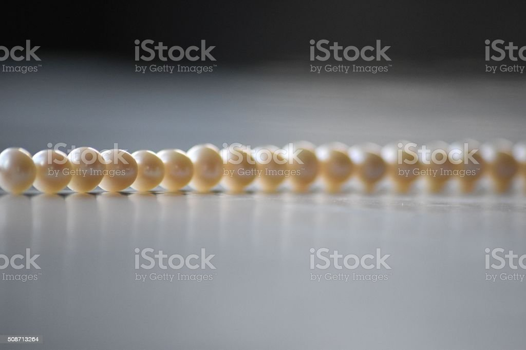 Single string of pearls stock photo