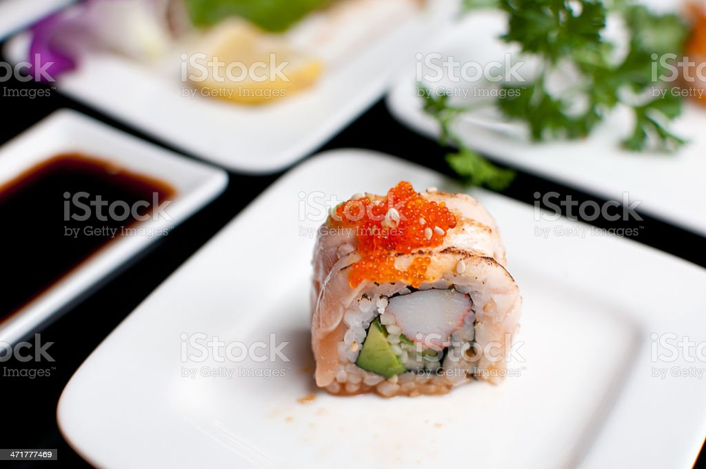 Single sushi roll on plate royalty-free stock photo