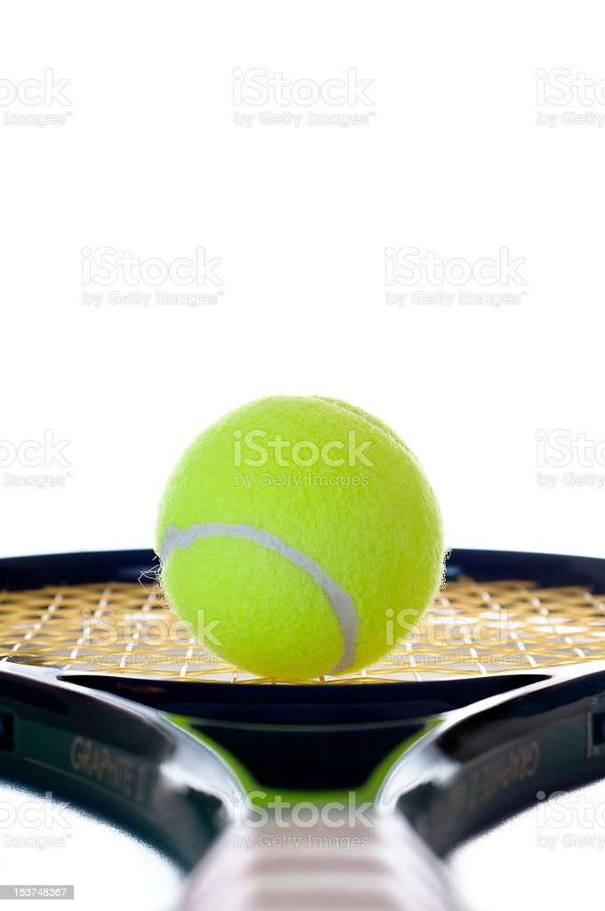 Single tennis ball looking down the handle royalty-free stock photo