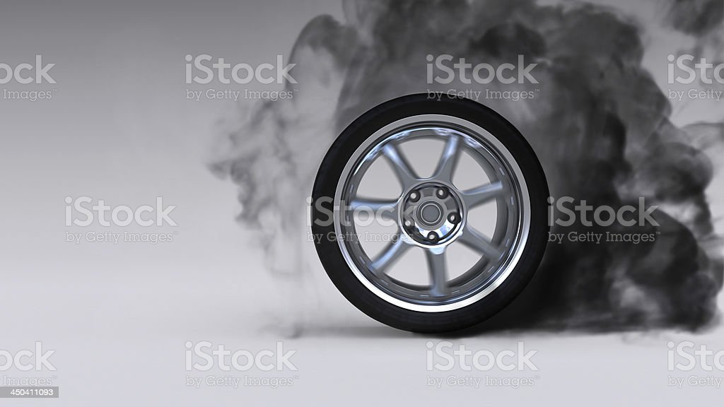 Single tire burning out on a white background stock photo