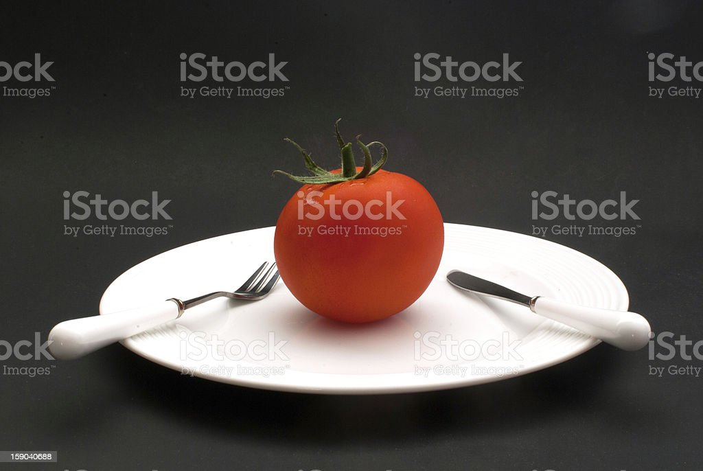 Single tomato on plate - dieting concept royalty-free stock photo