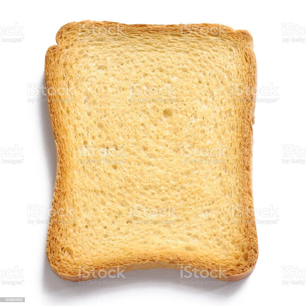 Single uniformly toasted piece of bread on white background royalty-free stock photo