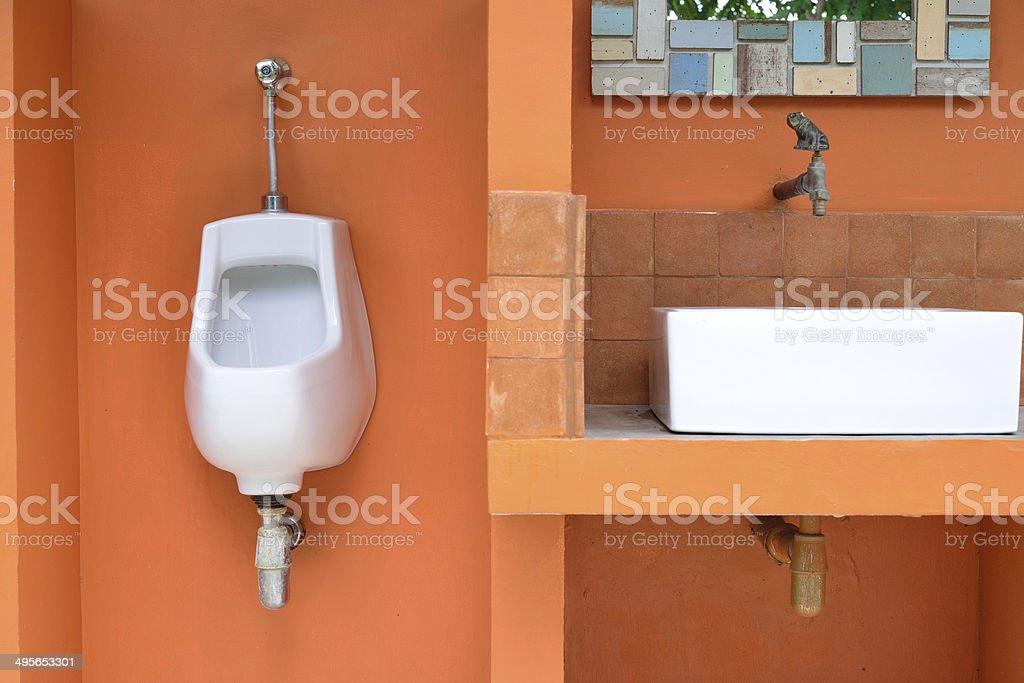 Single urinal in public toilet royalty-free stock photo