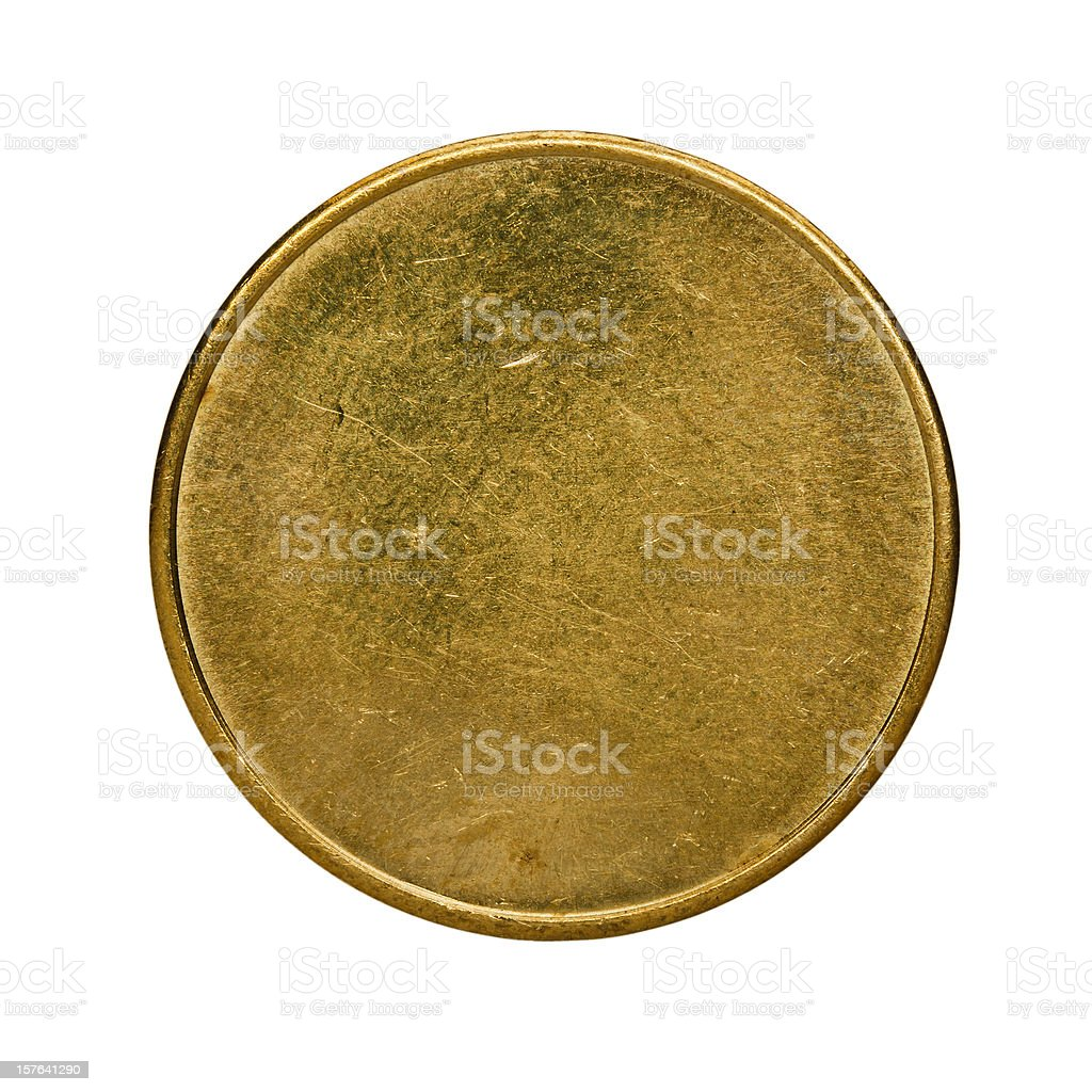 Single used blank brass coin, top view isolated on white stock photo