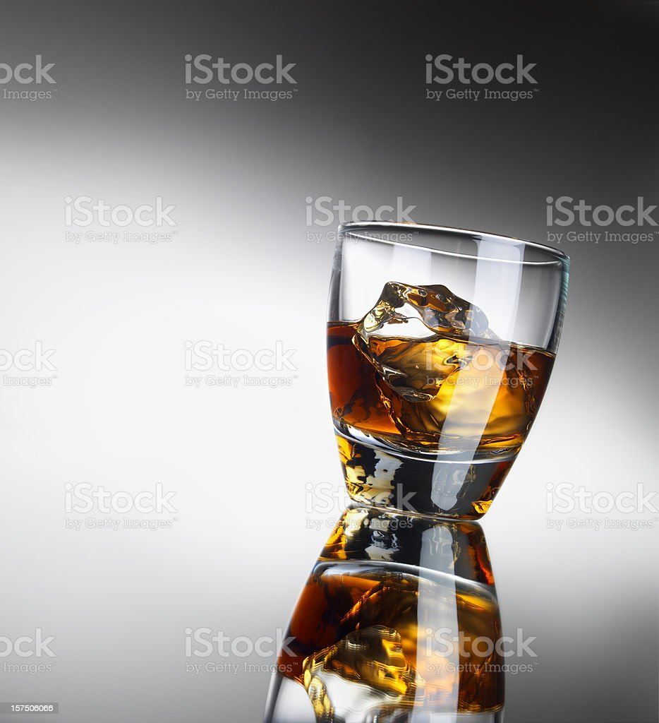 Single Whiskey Glass with reflection, Copy space royalty-free stock photo