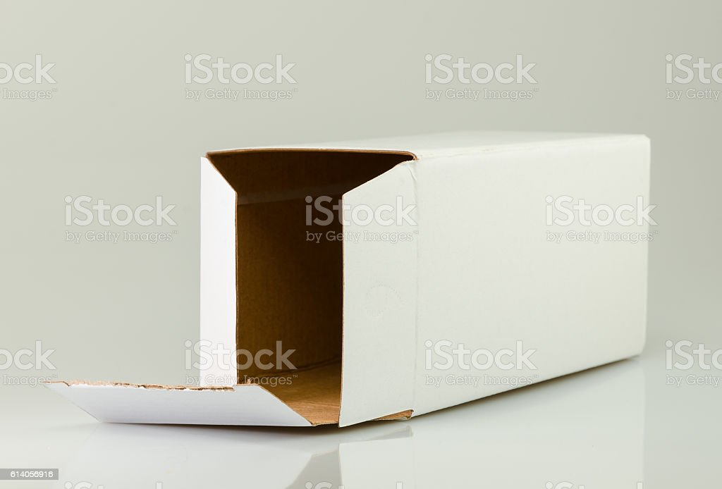 Single white cardboard packaging on a reflecting background stock photo
