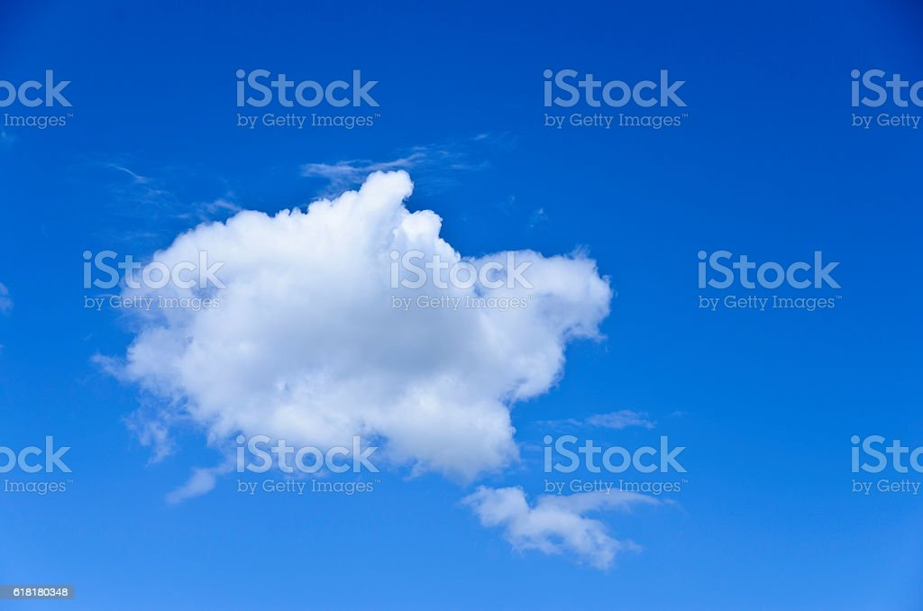 Single white cloud in a blue sky royalty-free stock photo